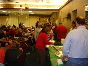 Elks members volunteered to cook the lunch.