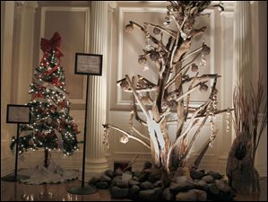 The Nemsys/ The Toledo Club tree, left, and Landscape Design, Jeff Moritz/Lutheran Social Services of Toledo tree.
