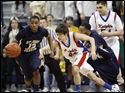 St. John's player Tarvis Malone (12) steals the ball from St. Francis' Jameson Williams (44).
