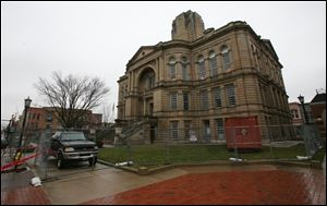 The Seneca County Courthouse sits silent as workmen busily labor inside this week, removing asbestos before demolition can begin.