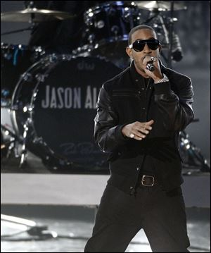 Ludacris as he performs at the Grammy Nominations Concert in Los Angeles. This year, 50 Cent, Quincy Jones and Ludacris released their own line of headphones.