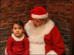 Audrey Geletka talks with Santa during the Junior League of Toledo's Breakfast with Santa.