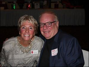 Party chairperson Ginger Safford with Ron VanDriesen.