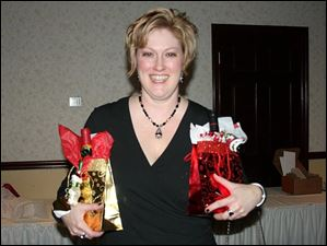 Molly MaGuire, recently returned from Iraq, bearing gifts.