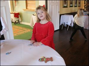 Katie Bell, 7, donned a darling red dress and red bow to meet Santa at Inverness Club.