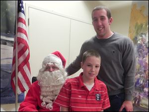 Big Brother Matt Auffrey and Little Brother Drew with Santa.
