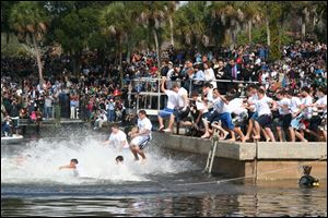 Boys jump into the water in Tarpon Springs, Fla., in preparation for the annual race to a cross tossed in the water on the Christian holiday of Epiphany.