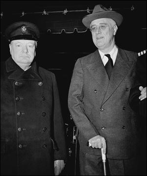 British Prime Minister Winston Churchill, left,  and President Franklin Roosevelt pose on the South Lawn of the White House on Dec. 22, 1941.