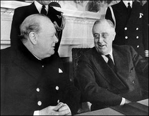 Prime Minister Winston Churchill, left, and President Franklin D. Roosevelt face each other at a conference table in the White House at Washington, Dec. 22, 1941.
