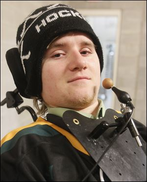 Former Clay High School hockey player Kyle Cannon, who was paralyzed while competing in 2008.