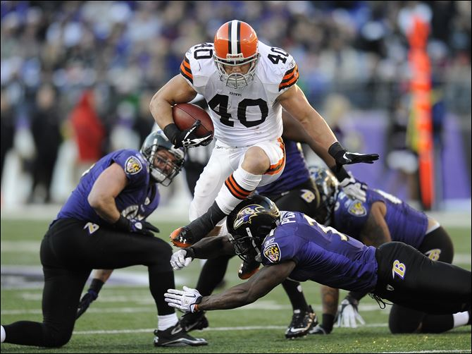 Cleveland rally falls short to Baltimore Browns running back Peyton Hillis (40) leaps over Ravens strong safety Bernard Pollard, bottom, in the second half of Saturday's game. Hillis had a season-high 112 yards rushing in the loss.