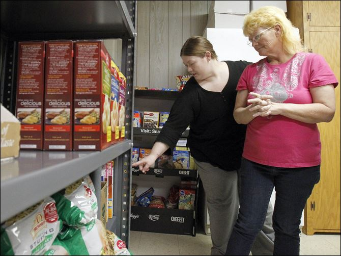 Food pantry brings hope to cancer fighters Mary Blair, left, helps her mom, Erma Oswalt, select food to take home while at Nightingale's Harvest food pantry at St. James Lutheran Church in Sylvania. The pantry helps people who, like Ms. Oswalt, have cancer.