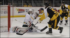 Clay's Alyssa Batch blocks a shot by Perrysburg's Patrick Sarni during the Kyle Cannon hockeyfest at the Huntington Center in Toledo, Ohio.