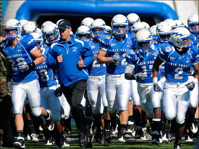 Air Force coach Troy Calhoun Air Force coach Troy Calhoun leads his team onto the field at Falcon Stadium. Calhoun has guided the Falcons to a 41-23 record in five seasons (2-2 in bowls).