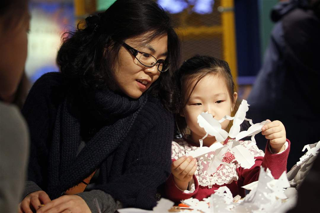 Yunju-Seo-left-Bowling-Green-admires-the-snowflake-made-by-her-daughter