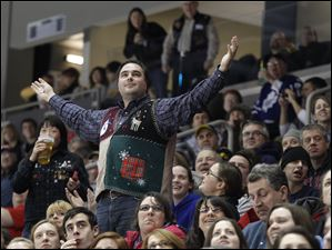New York resident Mikael Praud shows off his ugly sweater during the Walleye vs. Chicago game at the Huntington Center in Toledo, Ohio. Praud attended the game with his wife, Julia, who is from Perrysburg.