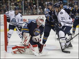 Walleye goalie Thomas McCollum blocks a shot by Chicago during 2nd period at the Huntington Center in Toledo, Ohio.