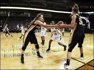 Northview player Chelsey Mason, 20, hands off to teammate J.J. Jessing, 52, against Start during the fourth quarter.