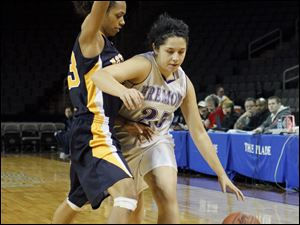 Fremont Ross player Alyssa Palmer, 25, tries to drive past Notre Dame Academy player Ashley Kynard, 23.
