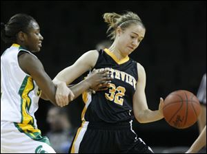 Northview player Lauren Yurjevic, 32, steals the ball from Start player Tai'ma James, 1, during the second quarter.