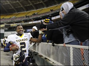 Toledo quarterback Terrance Owens greets fans after winning the Military Bowl.