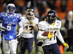 Toledo wide receiver Bernard Reedy, right, runs toward the end zone for a touchdown as Air Force defensive back Jon Davis (6) looks on.