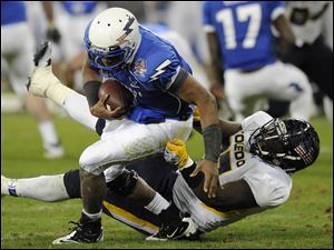 Toledo defensive lineman Malcolm Riley, right, sacks Air Force quarterback Tim Jefferson.