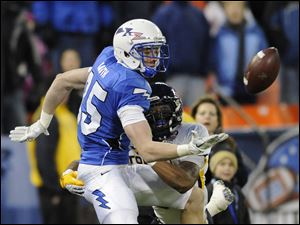 Air Force wide receiver Zack Kauth, left, battles for the ball against Toledo safety Diauntae Morrow.