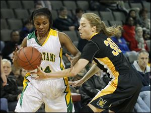 Sylvania Northview player Miriam Justinger, 30,  knocks the ball away from a Toledo Start player during the first quarter of the second game of the Blade Classic at Huntington Center, Thursday, December 29, 2011.