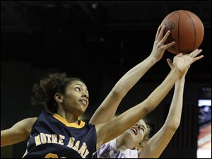 Notre Dame player Ashley Kynard, 23, and Fremont Ross player Whitney Overmyer, 30, battle for a rebound.