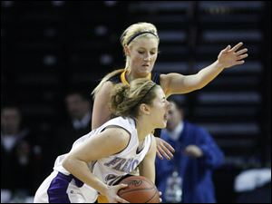 Fremont Ross player Whitney Overmyer, 30, tries to get past the defense of  Notre Dame Academy player Demy Whitaker, 12.