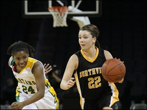 Northview player Skylar Rose, 22, brings the ball up court against Toledo Start player Victoria McDuffie, 24.