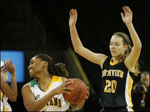 Start player DeShayla Mosby, 10, keeps the ball away from Northview's Chelsey Mason, 20.