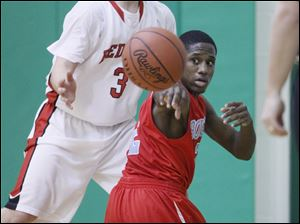 Bowsher player Dashan White, 2, is pressured by Bedford player Dennis Guss, 3, during the third quarter.