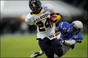 Toledo running back Adonis Thomas runs for a TD during the Military Bowl. It was UT's first bowl win since the 2005 GMAC Bowl.