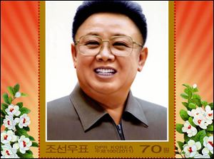 A commemorative stamp features the late North Korean  leader Kim Jong Il.