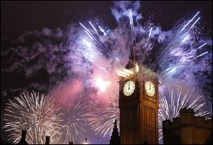 Fireworks explode over the Houses of Parliament, including St Stephen's Tower which holds the bell known as Big Ben as London celebrates the arrival of New Years Day Sunday.