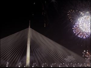 Fireworks illuminate the sky over newly-built cable-stayed Ada Bridge over the Sava river in Belgrade, Serbia.
