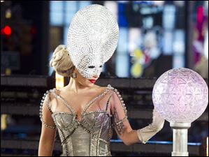 Lady Gaga appears on stage to start the ball drop in Times Square.