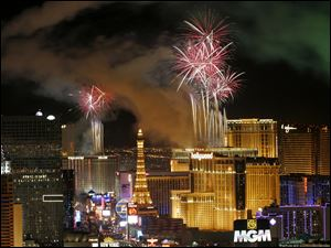 Fireworks light up the sky over the Las Vegas Strip.