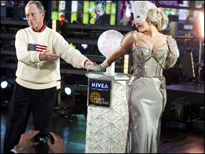 Lady Gaga and New York Mayor Michael Bloomberg appear on stage to start the ball drop during the New Year's Eve celebration.