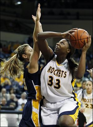 University of Toledo center Yolanda Richardson (33) goes to the net against Marquette's Cristina Bigica (35) Saturday.