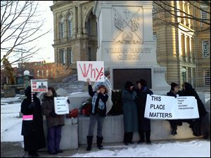 A group of women protest the Seneca County courthouse's demolition Tuesday.