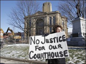 Suzanne Smith of Eden Township in Seneca County demonstrates outside the Courthouse.