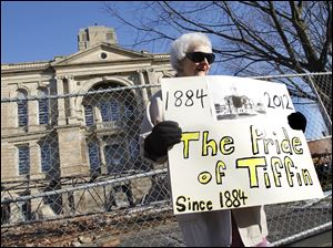 Elva Einsel, 83, of Tiffin, poses for a photograph outside the Seneca County Courthouse. She has lived in Tiffin for 21 years.