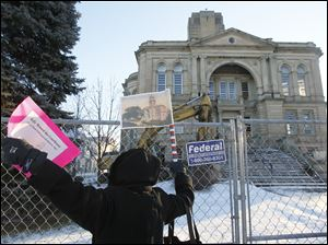 Nancy Rubenstein, of Tiffin, stands in front of the courthouse.