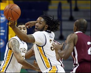 University of Toledo forward Reese Holliday (32) steals the ball from Indiana University-Northwest forward Baile Barnett (2) Tuesday, at Savage Arena in Toledo, Ohio.