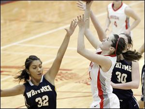 Jen Vliet, center, of shoots the ball past Whitmer's Tara Kellerbauer, left, and Ashley Finch, right.