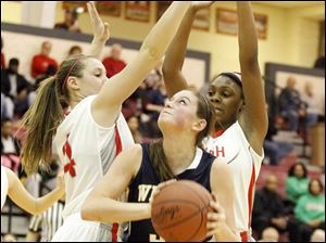 Panthers' Ashley Finch, center, looks to shoot the ball past the defense of Central Catholic's Jamie Sobczak, left, and Deonna Murdock, right.