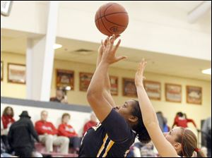 Panthers player Keshyra McCarver takes a shot during girls basketball against the Irish of Central Catholic.